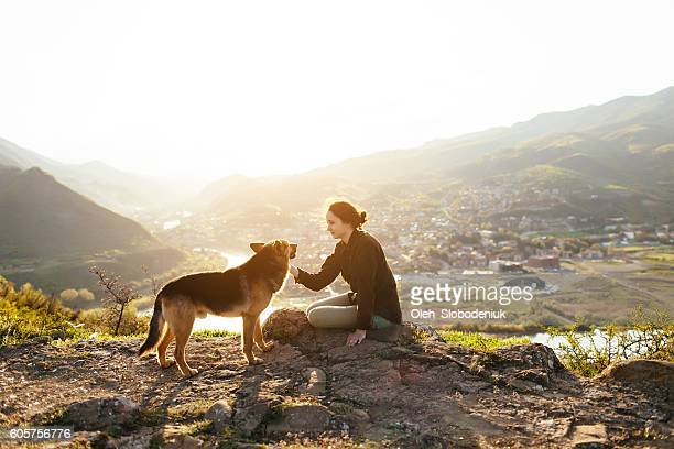 Young girl with dog on the background of town