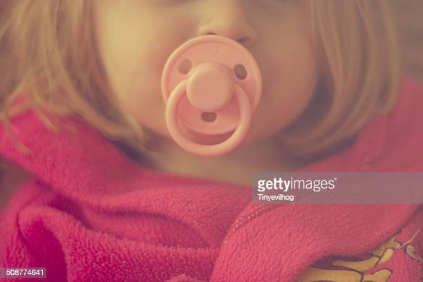 Young girl with dummy