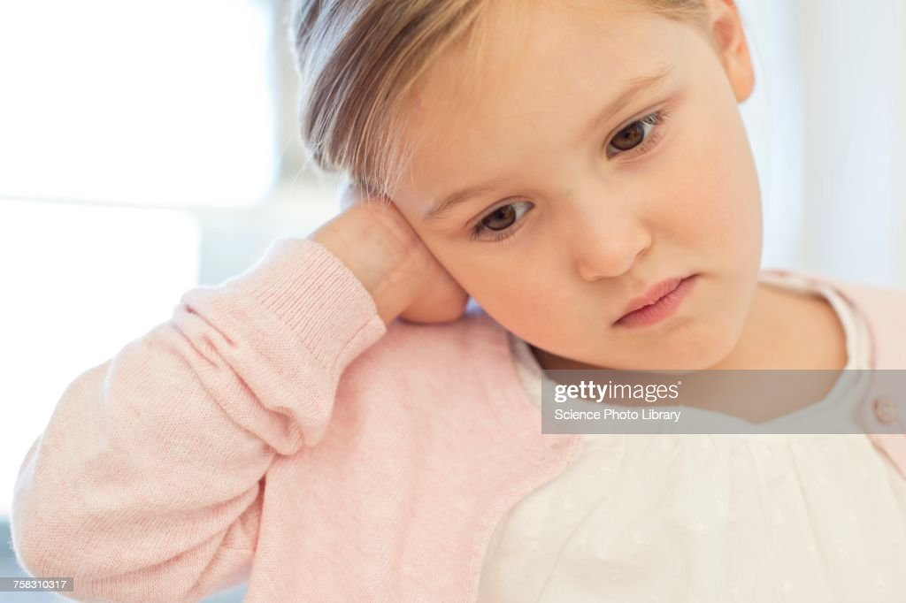 Young girl with ear ache : Stock Photo