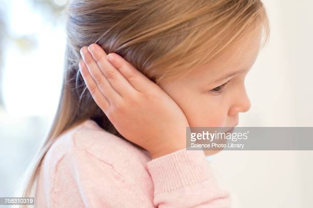 Young girl with ear ache