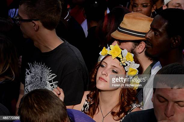 A young girl with flowers on her head and the 420 symbol on her cheek enjoyed the rap music of BoB who performed at the Colorado 420 Rally at Civic...