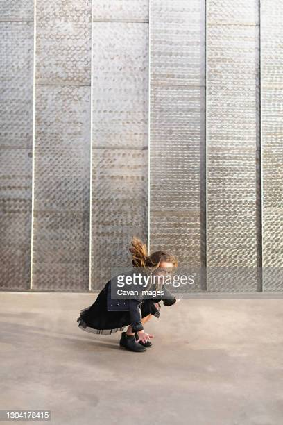 young girl with flying hair jumping up and down. - silver boot stock pictures, royalty-free photos & images