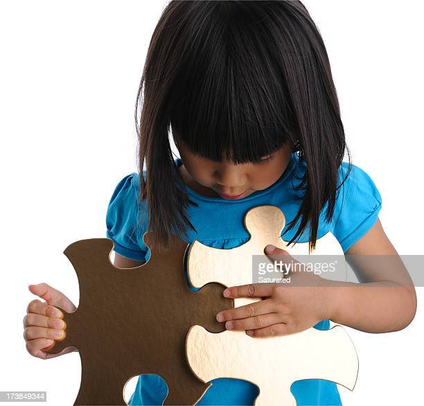 Young Girl with Golden Puzzle Pieces