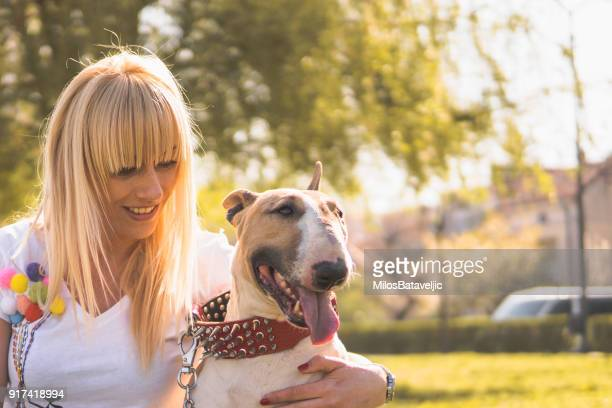 young girl with her dog - bull terrier stock photos and pictures