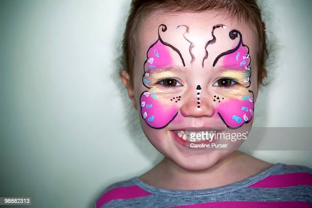 young girl with her face painted as a butterfly - face paint stock pictures, royalty-free photos & images