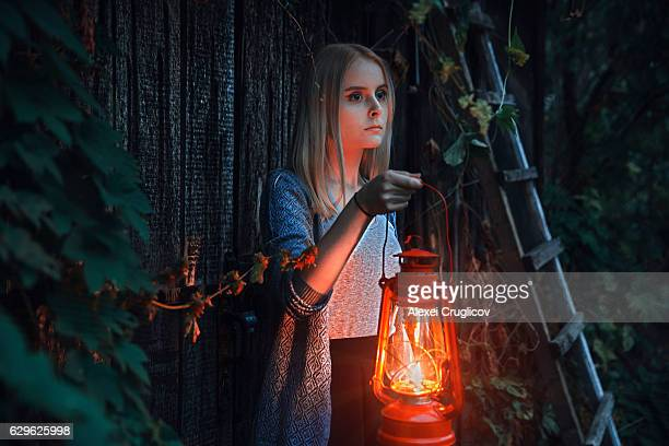 young girl with lantern in fairy tale - ランタン ストックフォトと画像