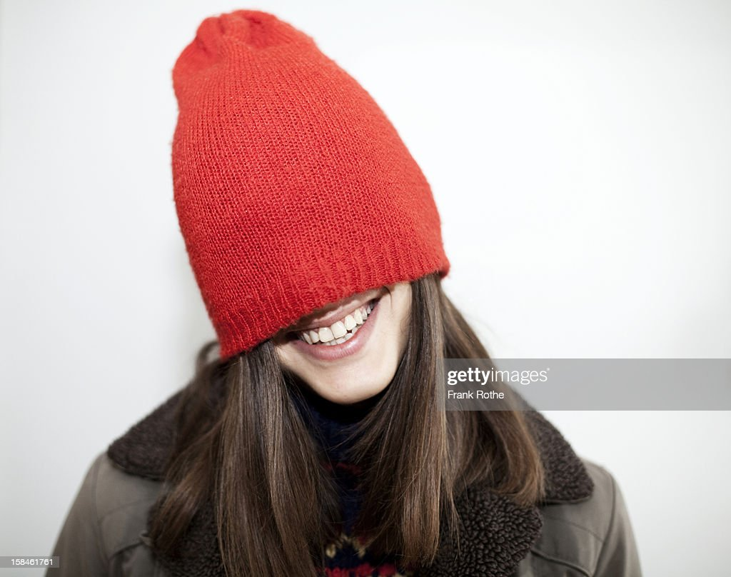 young girl with long brown hair and a red cap on : Stock Photo