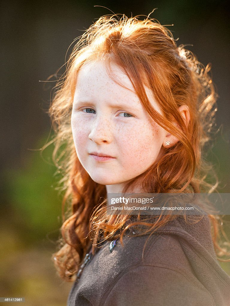 young girl with red hair stock photo image of forest young girl with long red hair in autumn sunlight high res