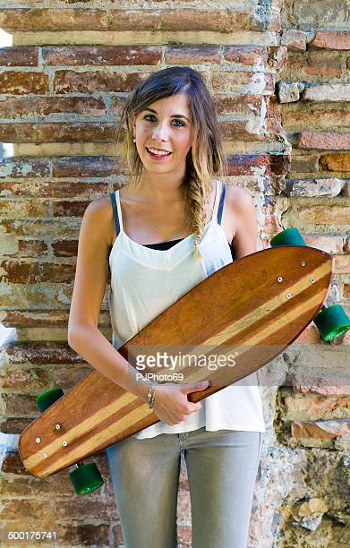young girl with longboard - pjphoto69 stock pictures, royalty-free photos & images