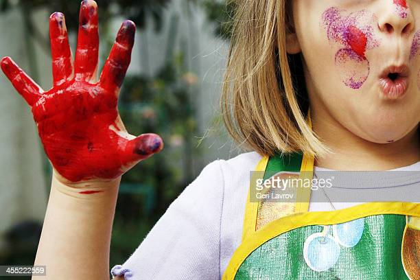 young girl with painted face and hand - dirty little girls photos stock pictures, royalty-free photos & images