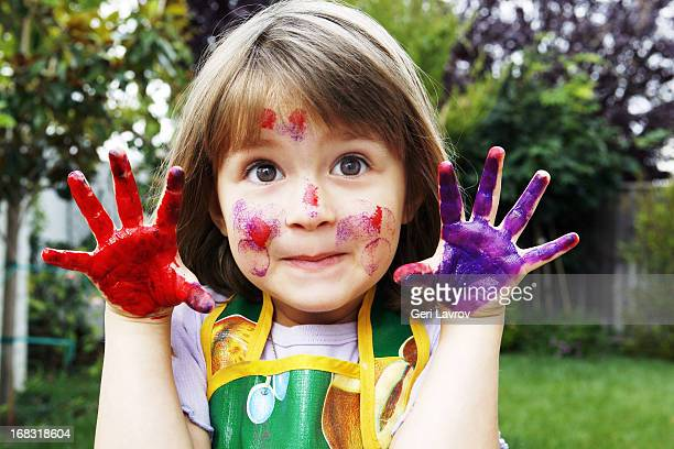 young girl with painted hands and face - dirty little girls photos stock pictures, royalty-free photos & images