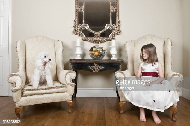 Young Girl (5-6) with Pet Poodle in Room