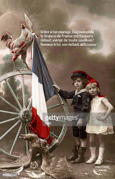 Young girl with Phrygian cap and little boy holding a french flag Gallic cock is proud on a wheel at his heel is the german eagle dead postcard circa...