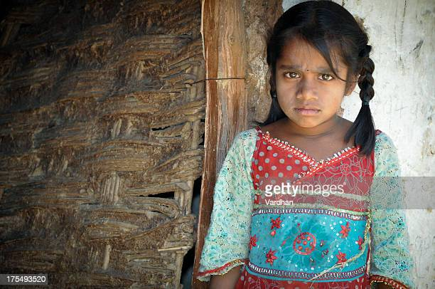 Young girl with pigtails, wearing rural clothes