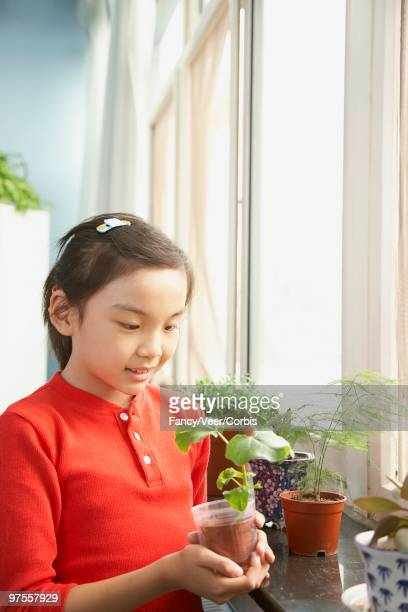 Young girl with plants