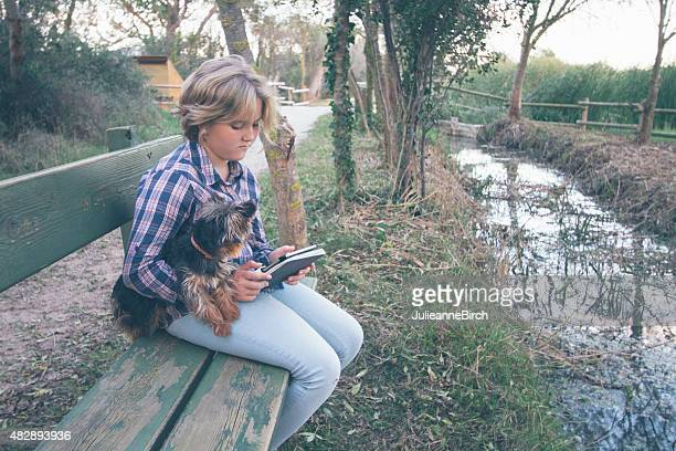 Young girl with puppy using technology