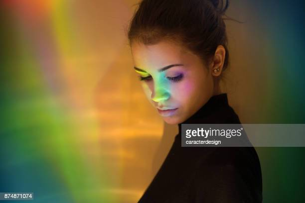 Young girl with rainbow reflections