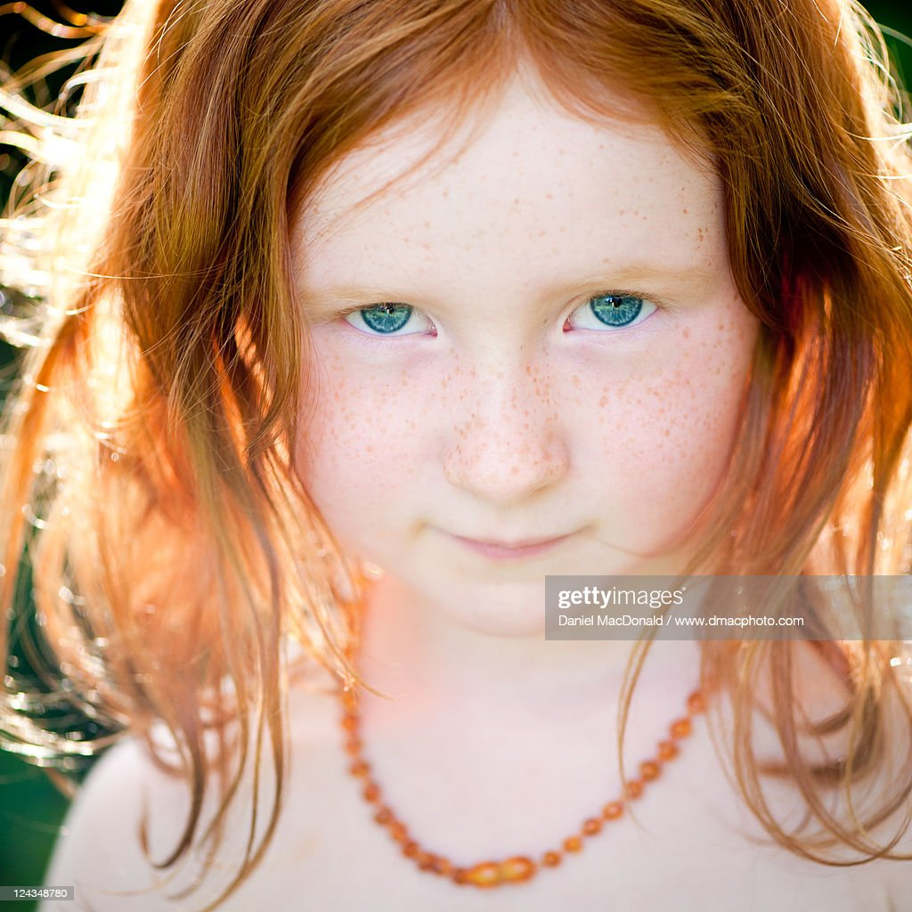 young girl with red hair stock photo image of forest young girl with red hair and blue eyes high res stock