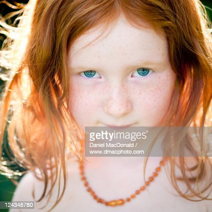 young girl with red hair and blue eyes stock photo getty. Black Bedroom Furniture Sets. Home Design Ideas