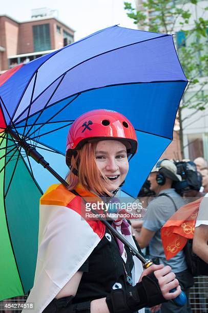 Young girl with red hair and with a rainbow umbrella during Pride Parade the closing activity of the Toronto Pride Festival celebrating the history...