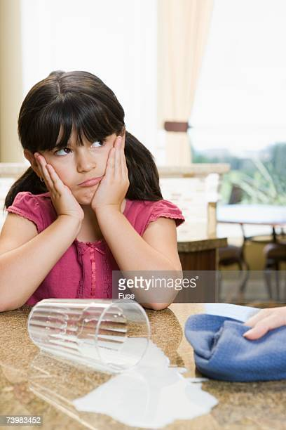 young girl with spilled milk - bad bangs stock pictures, royalty-free photos & images
