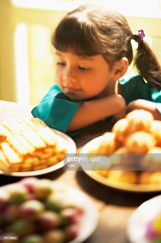Young Girl With Sweets During Malaysian New Year Stock Photo