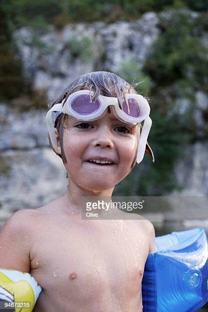 young girl with swimming glasses