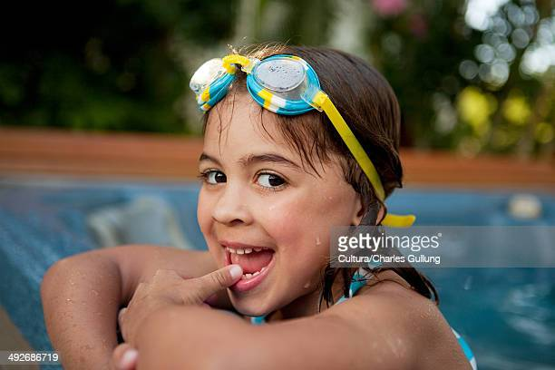 young girl with swimming goggles in hot tub - girls in hot tub stock photos and pictures