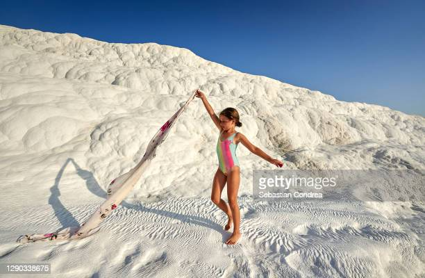 young  girl with the scarf stretched out, on travertine pools and terraces in pamukkale. cotton castle in southwestern turkey - royal tour stock pictures, royalty-free photos & images