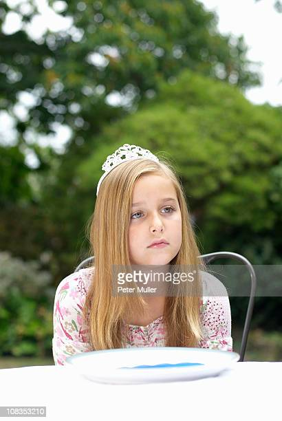 Young girl with tiara on, daydreaming