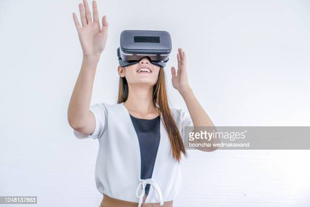 young girl with virtual reality glasses. isolated on white background. vr headset. - 仮想空間の視点 ストックフォトと画像