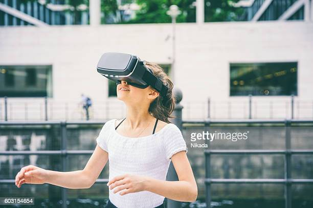 young girl with virtual reality headset