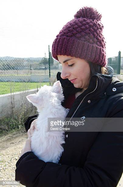 Young girl with Westie puppy