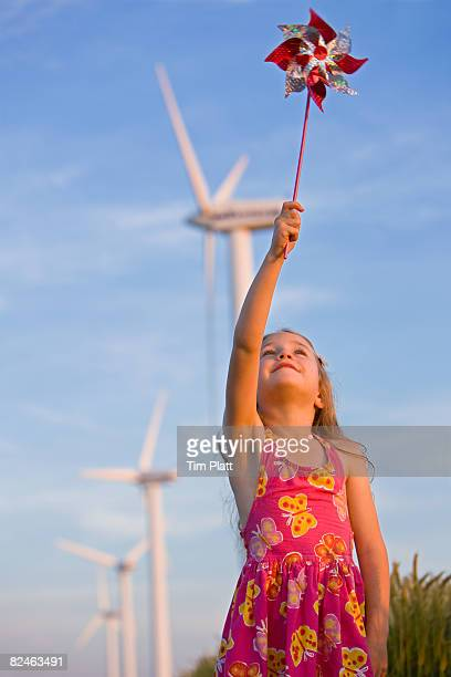 Young girl with windmills