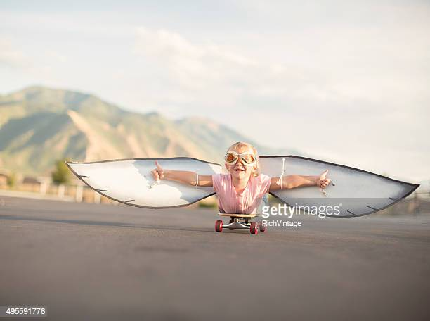 Young Girl with Wings Flies On Skateboard