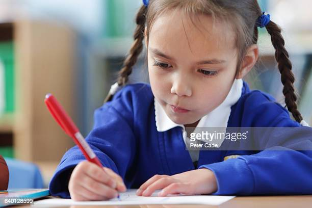 young girl working in classroom - primary school child stock pictures, royalty-free photos & images