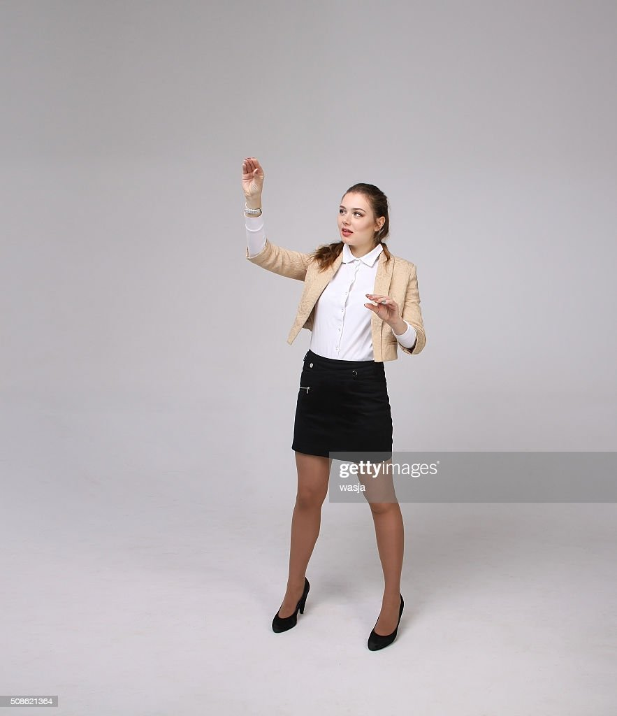 Young girl working with virtual screen : Stock Photo