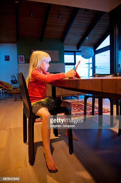 young girl working/playing on her tablet computer