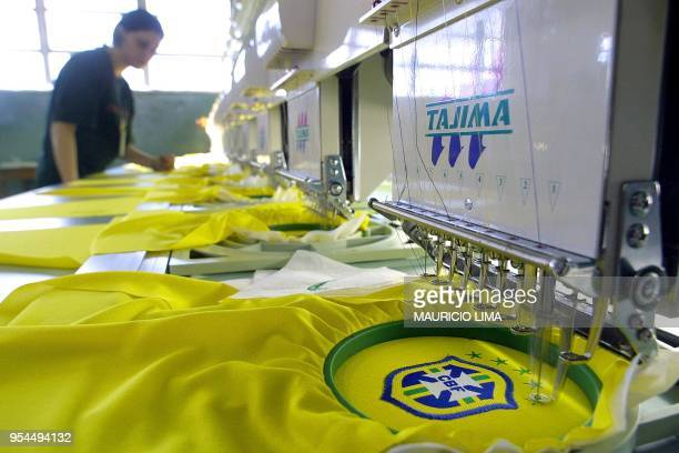 A young girl works on the production line at a factory where the new official jersey of the Brazilian soccer team are made in Sao Paulo Brazil 08...