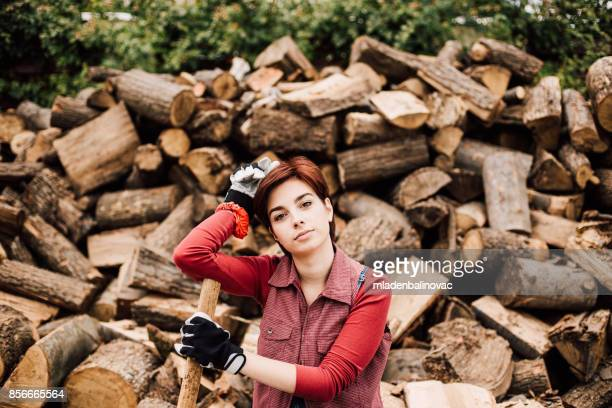 Young girl works with tree