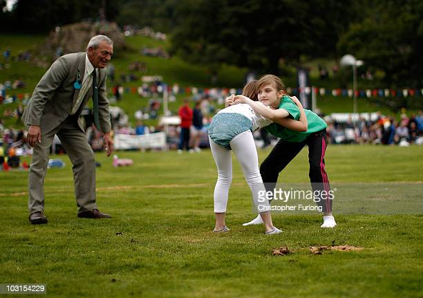 Young girl wrestlers of the Cumberland and Westmorland style compete at Ambleside Sports on July 29 2010 in Ambleside England The traditional style...