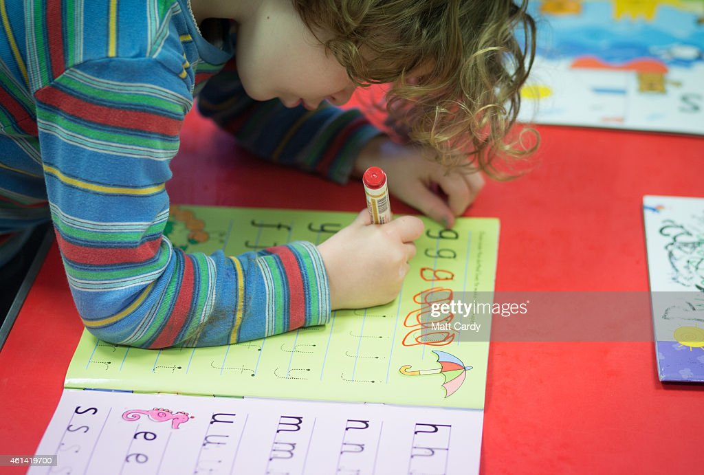A young girl writes letters at a playgroup for pre-school aged children in Chilcompton near Radstock on January 6, 2015 in Somerset, England. Along with the health and the economy, education and childcare are to be key issues in the forthcoming election.