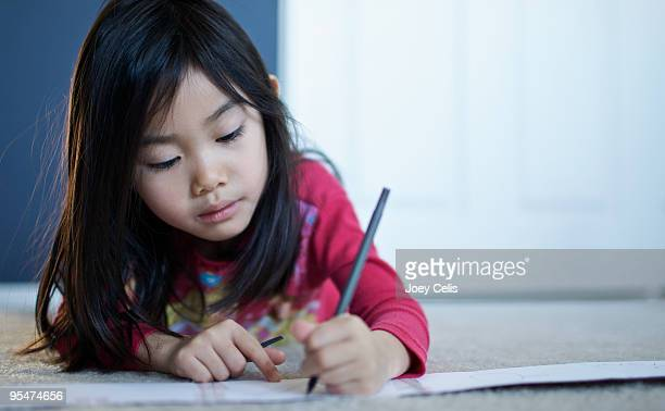 young girl writing a letter on the floor - message stock pictures, royalty-free photos & images