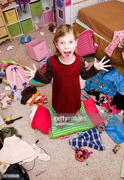 Young girl yelling in very messy bedroom
