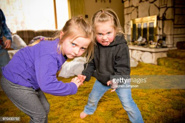 young girls act tough on montana ranch - authority stock pictures, royalty-free photos & images