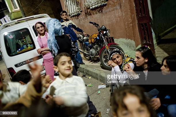 Young girls and boys enjoy a weddig party in the district Tarlabasi on May 14, 2006 in Istanbul, Turkey. Tarlabasi is a neighbourhood in the Beyoglu...