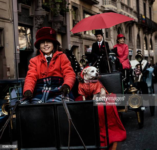A young girls and her dog take part in the 'Tres Tombs' procession through Barcelona honoring St Anthony patron saint of the guild of Carters and...