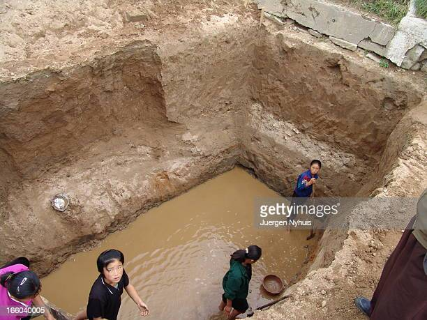 Young girls are excavating the pit for the new sewage tank of their school