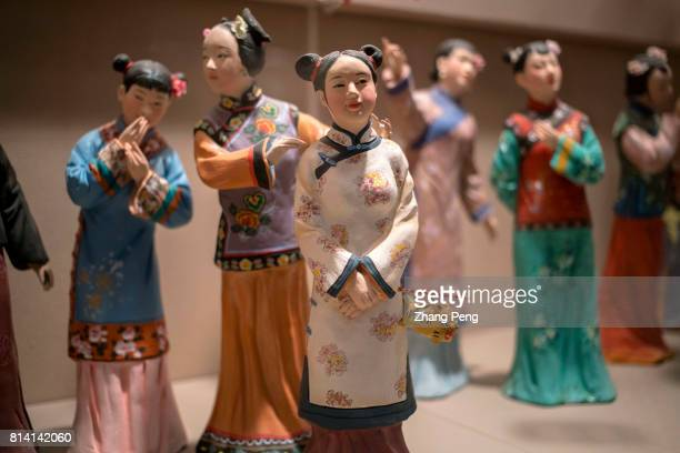 Young girls at lantern festival The clay sculptures depicts the daily life of old Beijing in early 1900s exhibited in the Capital Museum