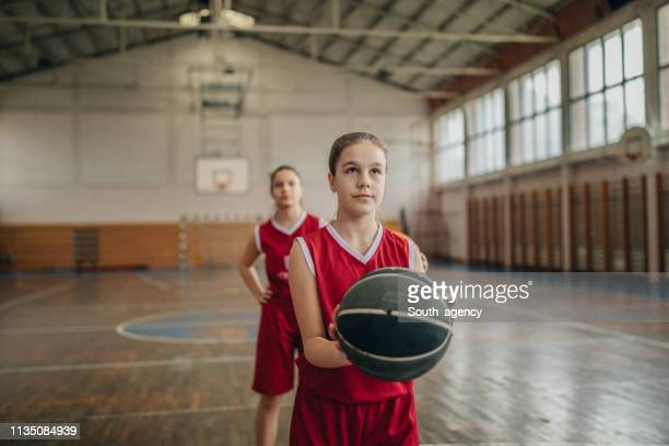 young girls basketball players shooting free throws on practice - hitting stock pictures, royalty-free photos & images